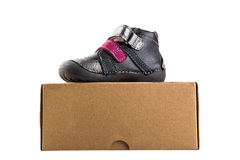 Grey baby's shoe on the box Royalty Free Stock Photo