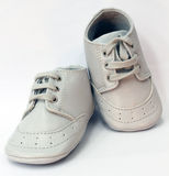 Grey baby shoes. Gender neutral grey baby shoes on a white background Stock Image