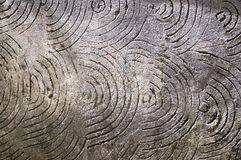 Grey background with circles and spirals. Concrete wall in daylight Stock Photo