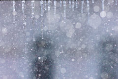 Grey background icicles Stock Photo