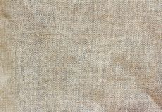 Grey background,the texture of the burlap.  stock images
