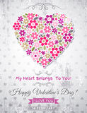 Grey background with valentine heart of spring flowers Stock Image