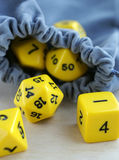 Grey bag with dices for board games. Stock Images