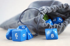 Grey bag with dices for board games. Royalty Free Stock Photos