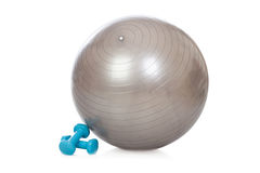 Grey ball and blue dumbbells for fitness Stock Image