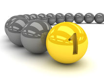 Grey balls with the gold leader in front. Royalty Free Stock Images