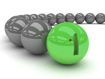 Grey balls with the green leader in front. Royalty Free Stock Images