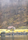 Grey Barn on the Fjord, Norway Stock Photography