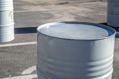 Grey barrel on black asphalt close up stock photo