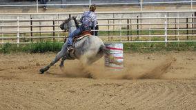 Grey Barrel Horse. Young girl competing in rodeo barrel racing competition Royalty Free Stock Photography