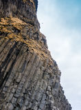 Grey basalt columns near Reynisdrangar beach, Iceland . Royalty Free Stock Photos