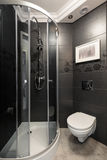 Grey bathroom with chrome accents. Image of little grey bathroom with chrome and white accents Stock Photography