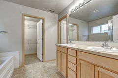 Grey bathroom interior with double sink wood vanity cabinet Stock Photography