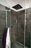 Grey bathroom. Interior of grey (gray) tiles theme bathroom stock images