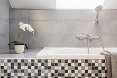 Grey bathroom with mosaic tiles Royalty Free Stock Images