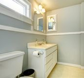 Grey bathroom with white simple cabinet. Stock Photography