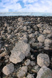 Grey beach boulders Royalty Free Stock Photography