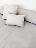 Grey bed linen and pillows Royalty Free Stock Images