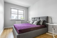Grey bedroom with double bed stock images