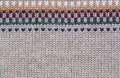 Grey and beige realistic knitting pattern royalty free stock image