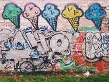 Grey-black fixie bicycle in front of the wall with ice-cream graffiti stock photo