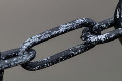 Chain Link. A grey and black metal chain link royalty free stock image