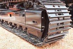 Grey and black metall caterpillar band of digger Stock Photography
