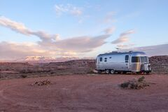Grey and Black Recreational Vehicle on Ground Under Blue and White Sky Stock Photo