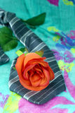 Grey black tie with red roses on a green background Stock Photography
