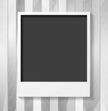Grey blank Polaroid photo frame on wood Royalty Free Stock Image