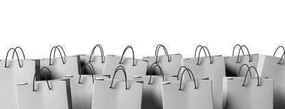 Smiling Woman Holding Smartphone And Shopping Bags On Grey Stock ...