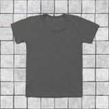 Grey blank t-shirt on tile background Stock Photo