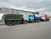 Grey, blue and orange trucks Royalty Free Stock Photo