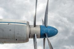 Grey Blue Plane over White Cloudes Royalty Free Stock Image