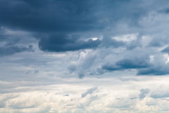 Grey blue rainy clouds in overcast sky Stock Images