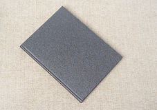 Grey book on the table Royalty Free Stock Photo