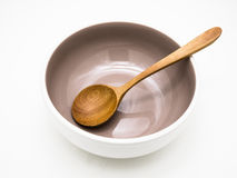 Grey Bowl mit hölzernem Löffel Stockfotos
