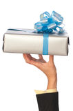 Grey box with blue bow as a gift Royalty Free Stock Images