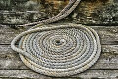 Grey Braided Rope on Wooden Plank Royalty Free Stock Photography
