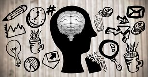 Grey brain on black head doodle against blurry wood panel Royalty Free Stock Image