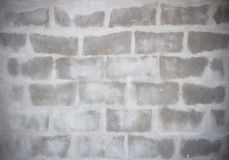 Grey Brick is Appear from cement wall Royalty Free Stock Image