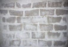 Grey Brick est apparaissent du mur de ciment Image libre de droits