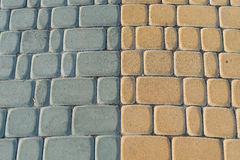 Grey brick. Nice floor of grey and yellow bricks in a square Royalty Free Stock Images