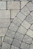 Grey brick paving background pattern Stock Image