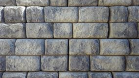 Grey brick retaining wall background stock images