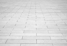 Grey brick stone street road. Light sidewalk Stock Photos