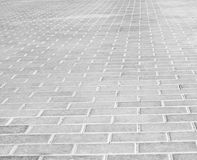 Grey brick stone street road. Light sidewalk Royalty Free Stock Photos