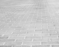 Grey brick stone street road. Light sidewalk Royalty Free Stock Photos