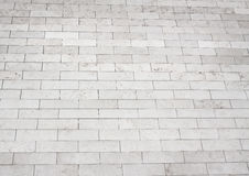 Grey brick stone street road. Light sidewalk Stock Photography