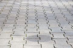 Grey brick stone street road. Light sidewalk, pavement texture Stock Photos